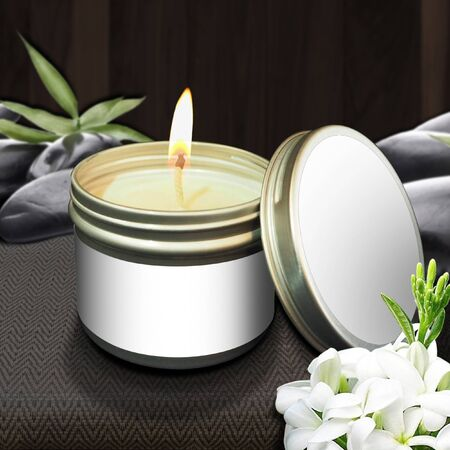 Scented candles in Mok flowers in flammable cans and placed in the center of the image with an empty product label. With a beautiful backdrop to relax Reklamní fotografie