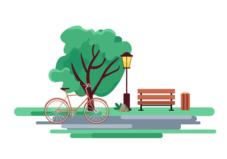 Blossoming city park in spring with a dense green tree, a bench and a bicycle.