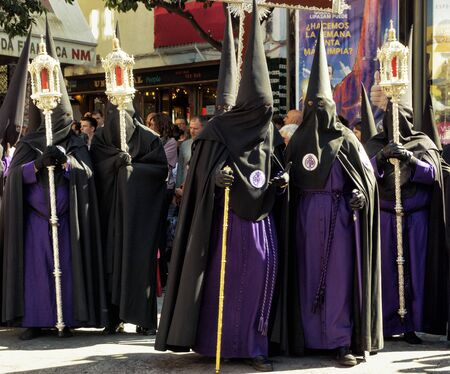 SEVILLE, SPAIN - MARCH 28: Brotherhood Group during Holy Week in Seville, Spain on March 28, 2018.