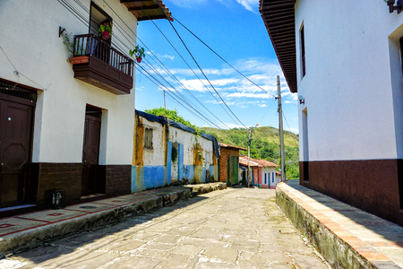 Colorful and old street in Charala, Santander, Colombia. Banco de Imagens