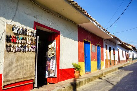 Colorful houses with colonial style and shops in Curiti, Colombia