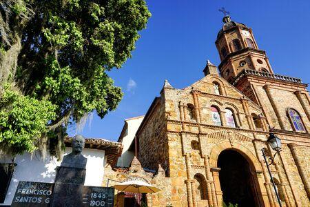 San Joaquin church entrance with Francisco Santos sculpture in Curiti, Santander, Colombia Banco de Imagens