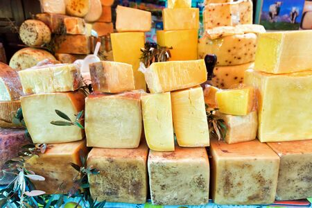 Market with variety of traditional and aged cheeses in Palermo, Italy