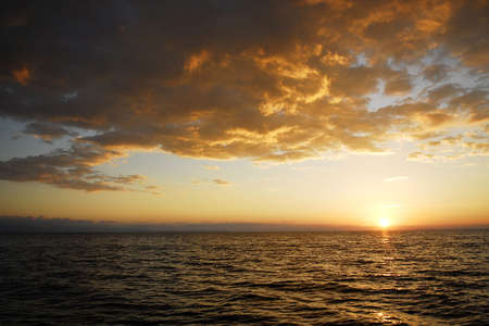 sea, sky and clouds during the sunset photo