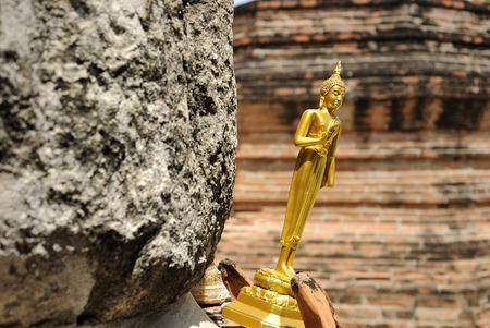 Small tilt buddha in temple 版權商用圖片