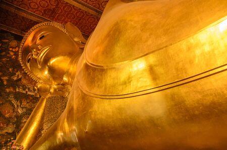 reclining: Reclining of gold buddha Editorial