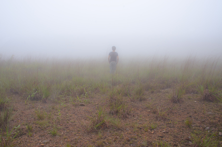 disappear: Alone man in fog