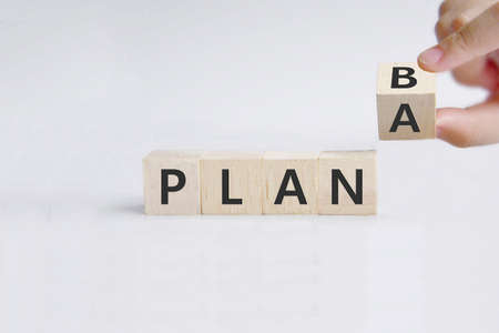Time for Plan B. Hand is turning a dice and changes the word