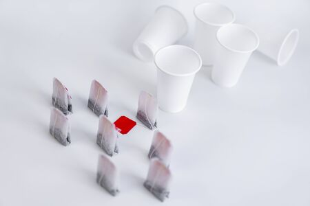 Tea bag and platik cups on a white background.Tea bag and platik cups on a white background