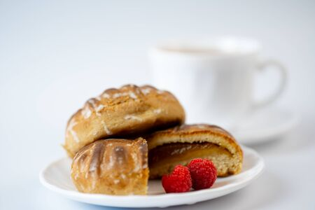 Gingerbread cookies with raspberries and tea on a white background.Gingerbread cookies with raspberries and tea on a white background