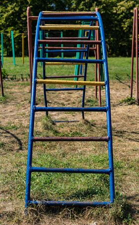 Ladder in the open air playground.Ladder in the open air playground Archivio Fotografico - 134727829
