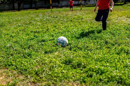Boy runs to the ball playing football.Boy runs to the ball playing football