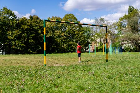 Childrens football goalkeeper stands on goal.Childrens football goalkeeper stands on goal