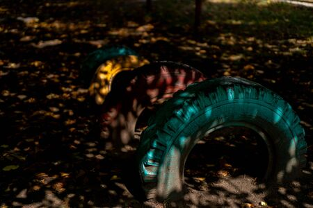 Car tires in the earth of different colors.Car tires in the earth of different colors Archivio Fotografico - 134726584