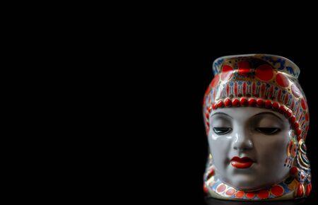 Indian souvenir, head on a black background.Indian souvenir, head on a black background 스톡 콘텐츠