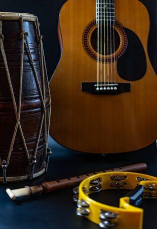 Drum duduk guitar tambourine on a black background.Drum duduk guitar tambourine on a black background