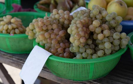 White grapes on the counter for sale.White grapes on the counter for sale.