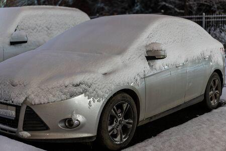 Already fallen snow lies on the car