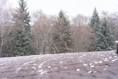 Snow falling on the roof