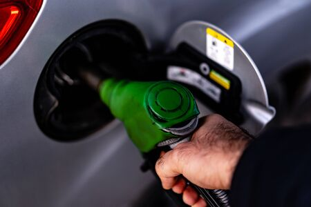 Fueling cars at a gas station