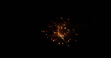 Fireworks at night time on a black sky background Stock Photo