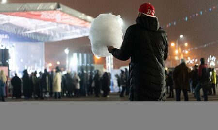 Man holds cotton candy in his hands