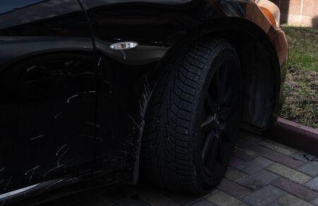 Black rims of a black sports car