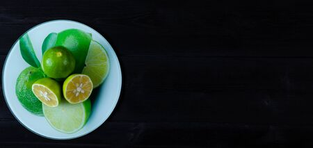 Lime on a tray and wooden background
