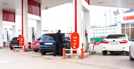 Gas station with cars refueling on it Stock Photo
