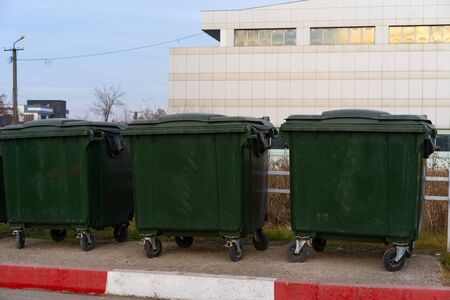 Closed green wheeled garbage cans Stock Photo