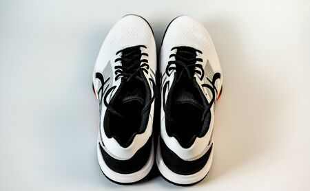 White tennis sneakers on a white background