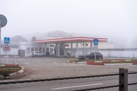 Gas station and cars on it
