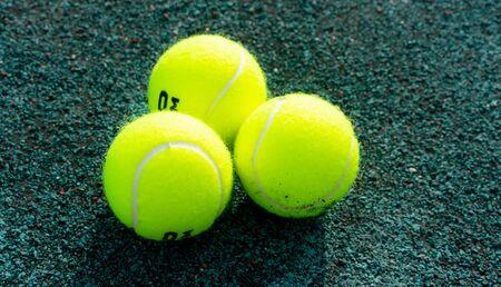 Tennis balls on the tennis court