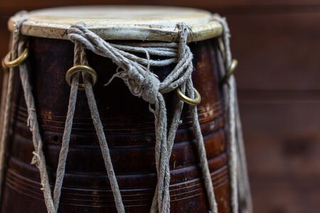 Hand drum on a wooden background 스톡 콘텐츠