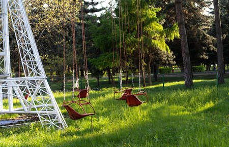 Empty swing of a children's attraction
