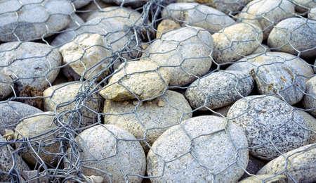 Stones are under the metal grate Stock fotó