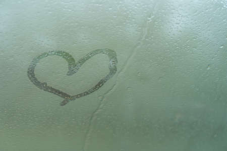 Image of heart on wet glass