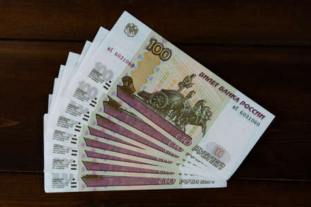 Russian money on a wooden background
