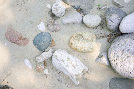 Various stones in the sand