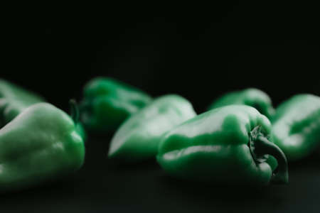 Green, bell peppers on a black background Stock fotó - 152479787