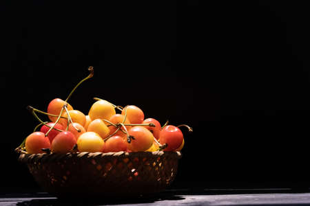 Yellow cherries in a small basket