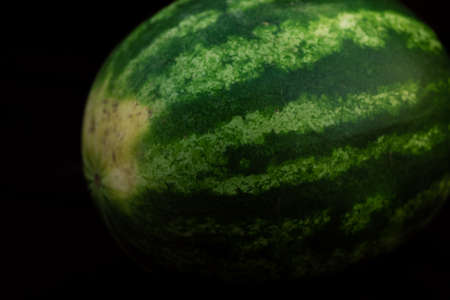 Ripe watermelon on black background