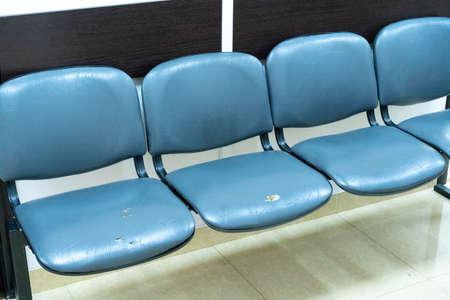 Worn Indoor Waiting Padded Seats