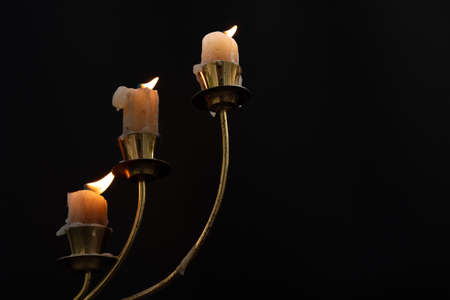 Candles burn in the dark Stock fotó