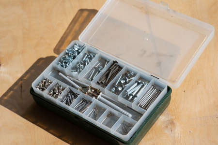 Nails, screws, screws and nuts are in the case