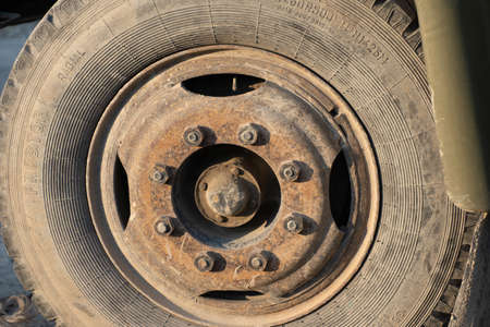 Old wheel with a rusty disc