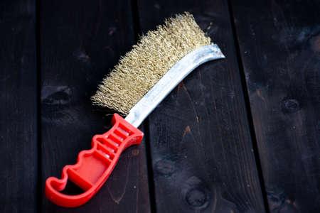 Wood brushing tool, lying on a wood surface Stock fotó