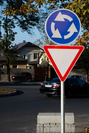 Traffic sign, roundabout of cars on the road 免版税图像