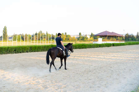 Man riding a horse at the racetrack