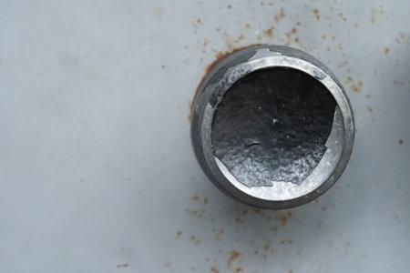 Metal handle fixed to the door